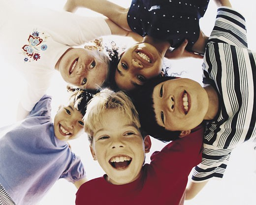 Stock Photo: 1491R-1019157 Group of children in huddle
