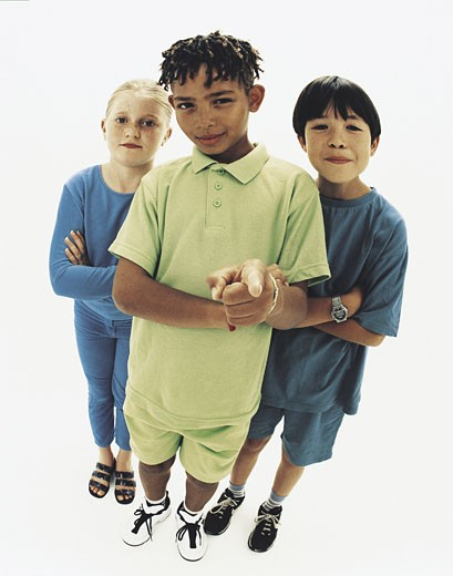 Stock Photo: 1491R-1019171 Boys and girl standing together, looking serious