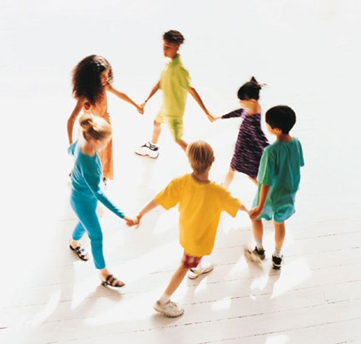 Children joining hands, walking in circle : Stock Photo