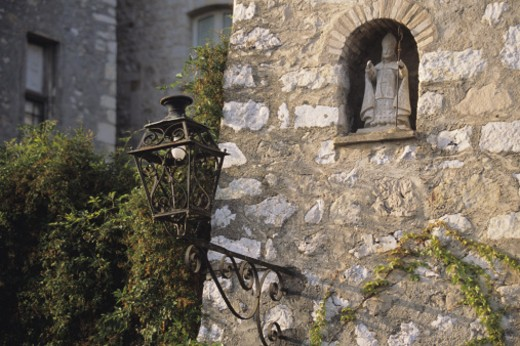 Statue and lamp close-up, medieval village of Tourettes sur Loup, French Riviera, Cote d' Azur, France : Stock Photo