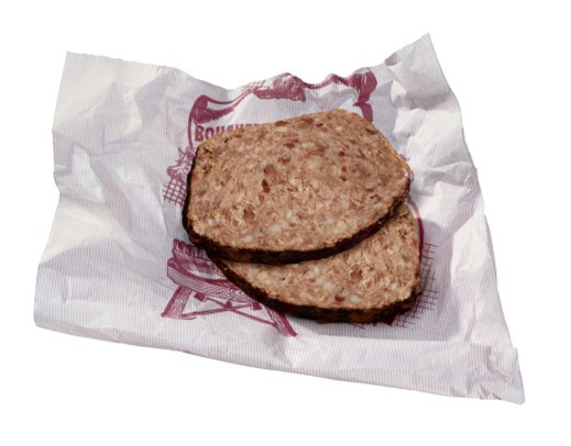 Stock Photo: 1491R-1022579 Slice of Pate on Wrapper