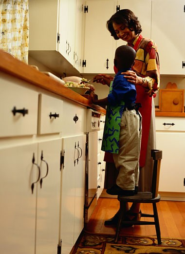 Mother and Son Cooking in the Kitchen : Stock Photo