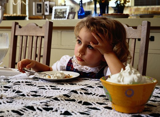 Girl Sitting at a Table by a Bowl of Whipped Cream : Stock Photo