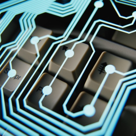 Circuitry Superimposed on Computer Keys : Stock Photo