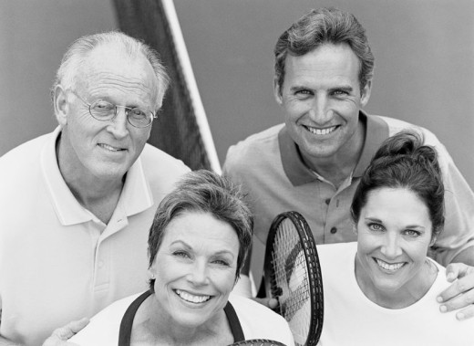 Stock Photo: 1491R-1031671 Portrait of a Group of Smiling Tennis Players