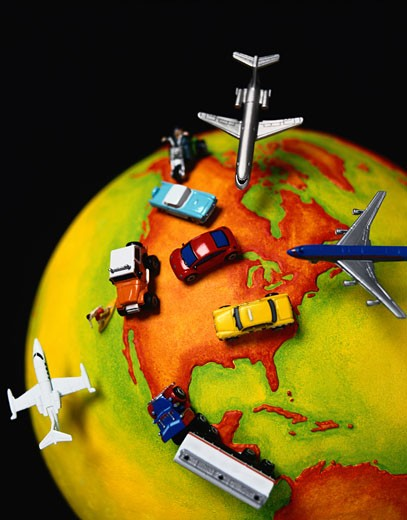 Stock Photo: 1491R-1031826 Toy Airplanes, Cars and Trucks on a Globe