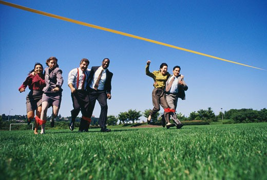 Stock Photo: 1491R-1032040 Businesspeople in a Three-legged Race