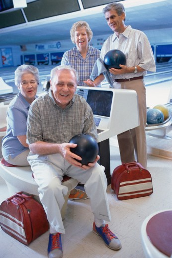 Two elderly couples bowling : Stock Photo