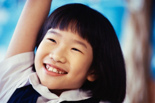 Asian girl raising hand : Stock Photo
