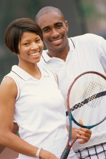 Stock Photo: 1491R-1033384 African American couple with tennis racquet