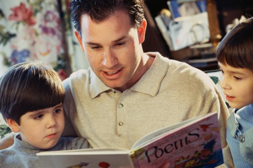Father reading book with children : Stock Photo
