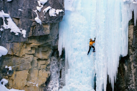 Stock Photo: 1491R-1034456 Mountaineer climbing ice