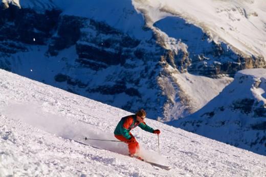 Skier descending mountain : Stock Photo