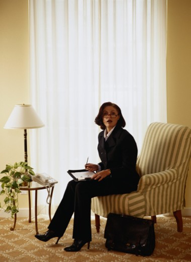 Stock Photo: 1491R-1036324 Businesswoman Working in Hotel Room