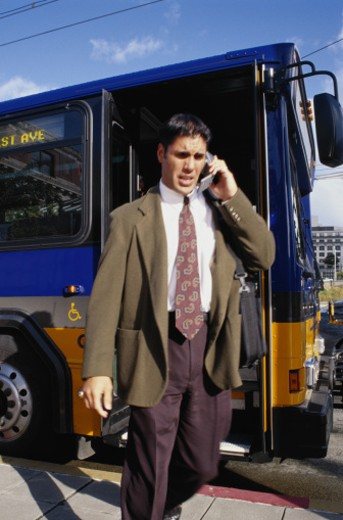Stock Photo: 1491R-1036372 Businessman Exiting Bus