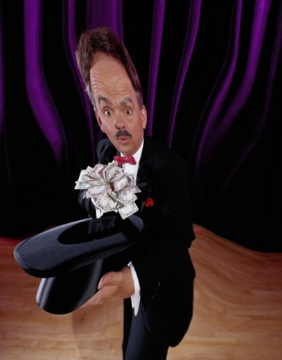 Distorted Magician with Top Hat and Money : Stock Photo