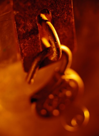 Open Padlock Hanging From a Latch : Stock Photo