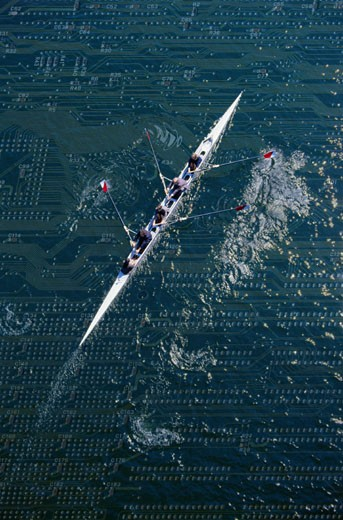 Four Businesspeople Rowing : Stock Photo