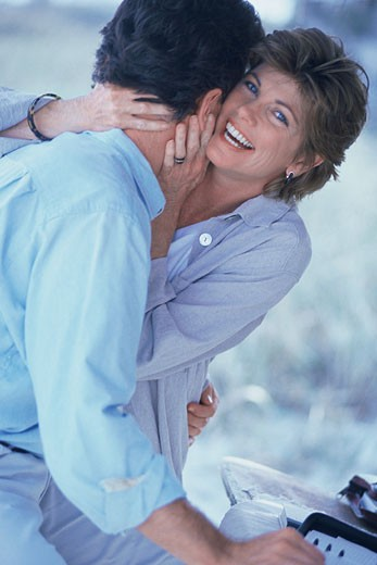 Woman hugging man : Stock Photo