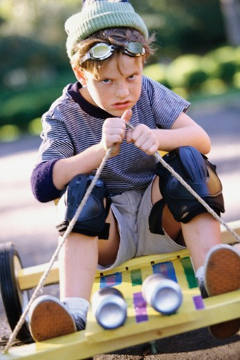 Stock Photo: 1491R-1039910 Boy driving go-cart