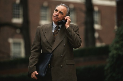Stock Photo: 1491R-1040600 Frowning Businessman with Cellular Phone