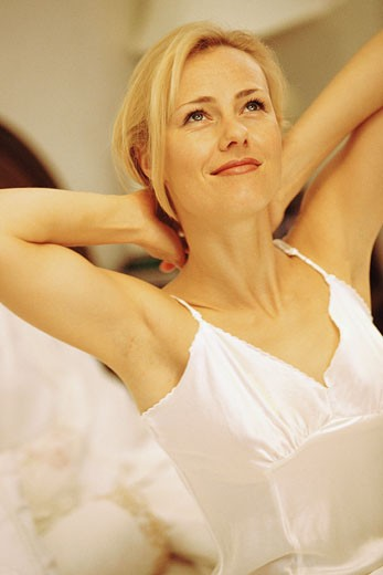 Stock Photo: 1491R-1044776 Woman stretching
