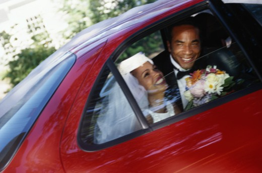 Bride and Groom in Car : Stock Photo