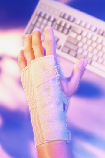 Hand with wrist support using keyboard : Stock Photo