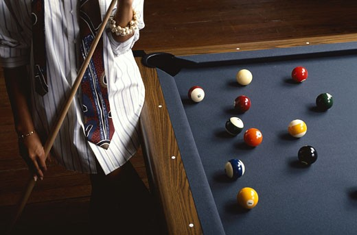 Woman with Cue Stick : Stock Photo