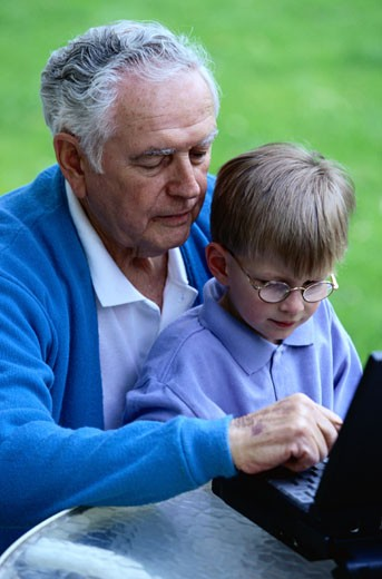 Grandfather and Grandson using Laptop : Stock Photo