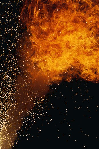 Stock Photo: 1491R-1057350 Fiery explosion with sparks