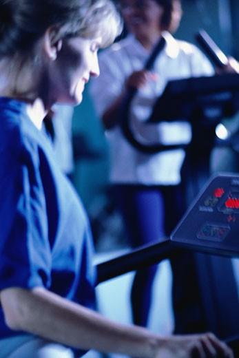Woman on treadmill : Stock Photo