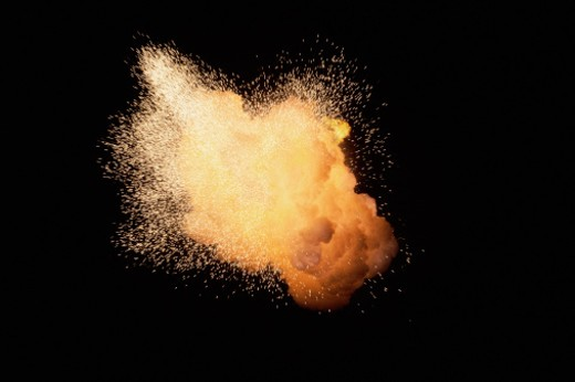Stock Photo: 1491R-1061647 Huge fireburst exploding with emanating sparks