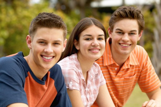 close up of three teenage friends (16-18) sitting : Stock Photo