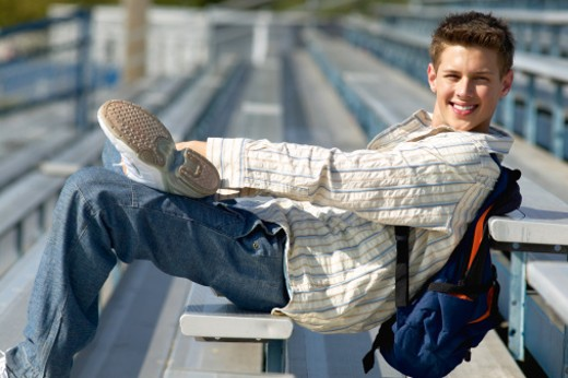 portrait of a teenage boy (16 - 18) sitting on steps : Stock Photo