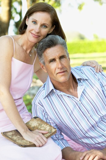portrait of a man and woman relaxing outdoors : Stock Photo