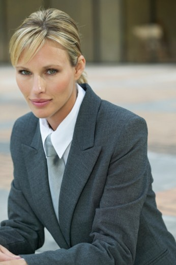 portrait of a businesswoman sitting on steps : Stock Photo