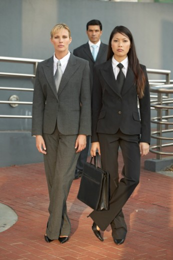 Stock Photo: 1491R-1063250 portrait of two businesswomen and one businessman