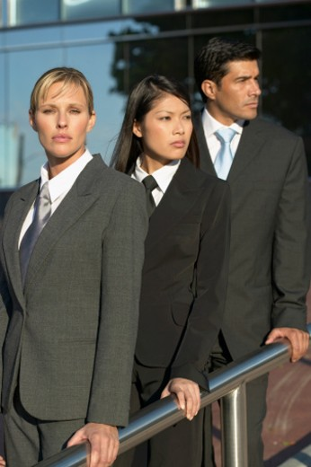 Stock Photo: 1491R-1063251 businesspeople leaning on a railing