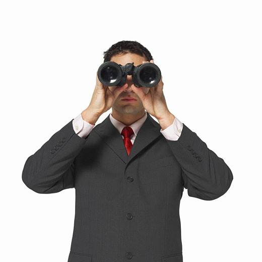Stock Photo: 1491R-1063636 front view of a businessman looking through binoculars