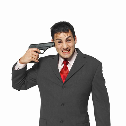 Stock Photo: 1491R-1063638 businessman pointing a gun at his head