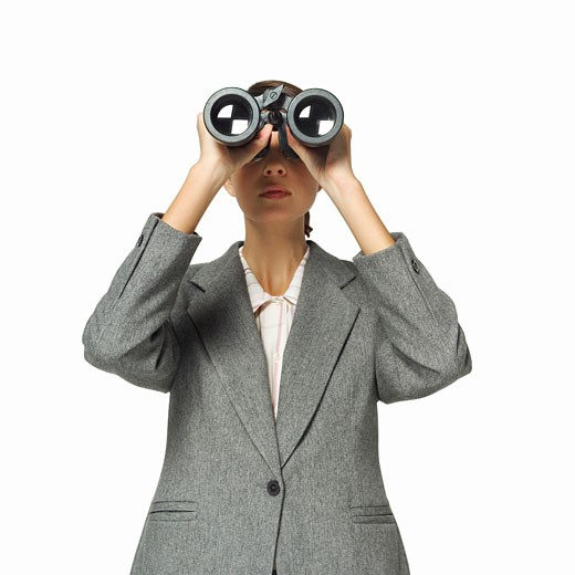 businesswoman looking through binoculars : Stock Photo