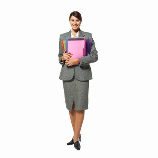 Portrait of a businesswoman holding files : Stock Photo
