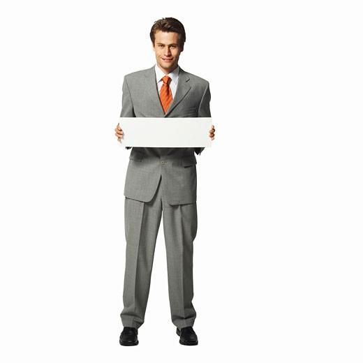 Stock Photo: 1491R-1063695 Businessman holding a blank card