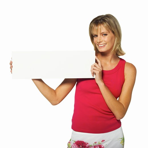 Woman holding a blank card : Stock Photo
