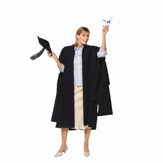 front view portrait of a woman wearing graduation gown with certificate and cap in her hand : Stock Photo