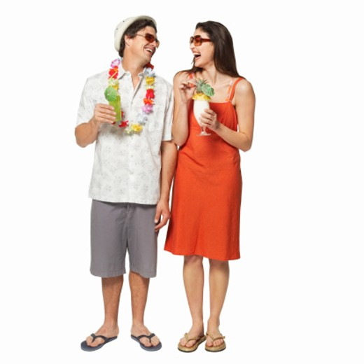 Couple drinking cocktails : Stock Photo