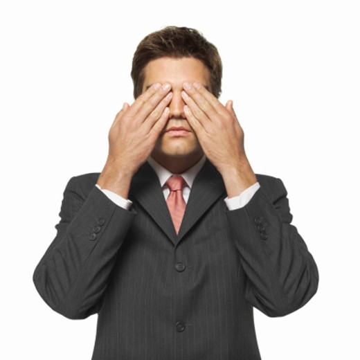 portrait of a man covering his eyes with his hands : Stock Photo