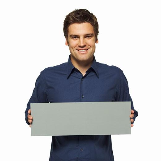 Stock Photo: 1491R-1063941 Portrait of man holding blank card