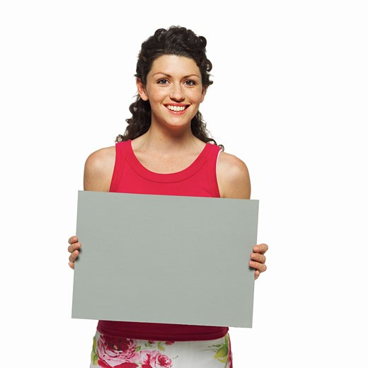 Stock Photo: 1491R-1063946 Portrait of woman holding blank card
